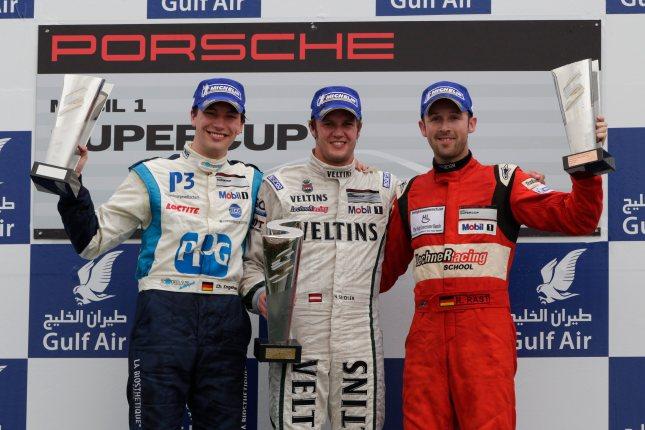 Podium Rennen 2: Christian Engelhart (D), Norbert Siedler (A), René Rast (D) Porsche Mobil 1 Supercup Bahrain 2012