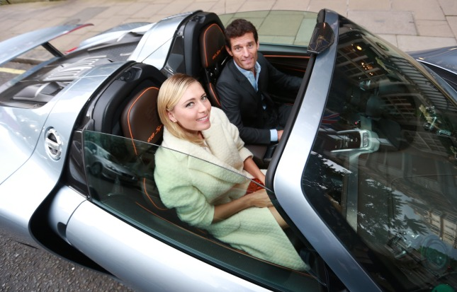 French Open winner, Maria Sharapova, is picked up from The Goring hotel in Central London by Porsche Works Driver and 'world's fastest chauffeur' Mark Webber, in the plug-in hybrid Porsche 918 Spyder and driven to the Women's Tennis Association (WTA) Pre-Wimbledon Party at the Kensington Roof Gardens.  Photo. Picture date: Thursday June 19, 2014. Hitting 0-60 mph in 2.5 seconds and with a top speed of 214 mph, the 918 Spyder is the most powerful road car Porsche has built to date, yet is exempt from the Congestion Charge as the plug-in hybrid super sports car emits less CO2 than most small cars and many other hybrid vehicles. Photo credit: Matt Alexander/PA Wire