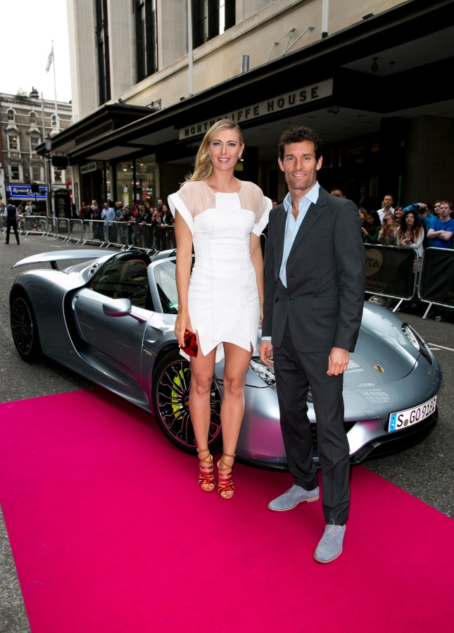 Porsche Brand Ambassadors Maria Sharapova and Mark Webber arrive with a Porsche 918 Spyder super sportscar for the WTA Pre-Wimbledon Party at Kensington Roof Gardens on June 19, 2014 in London, UK