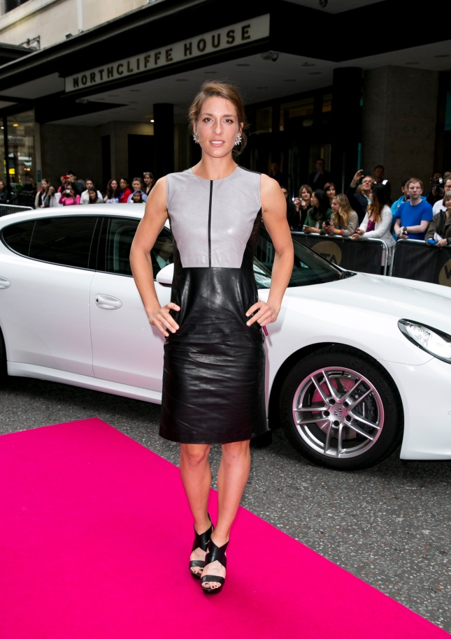 Andrea Petkovic arrives with a Porsche Panamera for the WTA Pre-Wimbledon Party at Kensington Roof Gardens on June 19, 2014 in London, UK