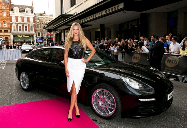 Victoria Azarenka arrives with a Porsche Panamera for the WTA Pre-Wimbledon Party at Kensington Roof Gardens on June 19, 2014 in London, UK
